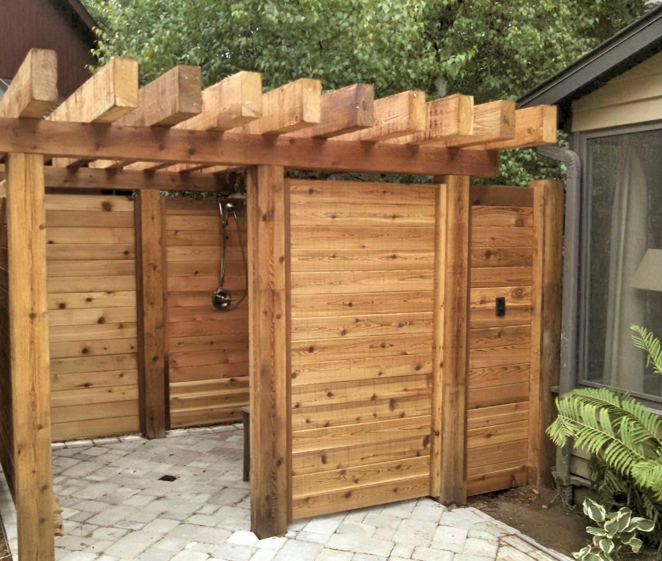 Horizontal cedar outdoor shower enclosure straight line